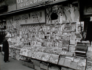 Berenice Abbott: Newsstand, 32nd Street and Third Avenue, Manhattan (1935)
